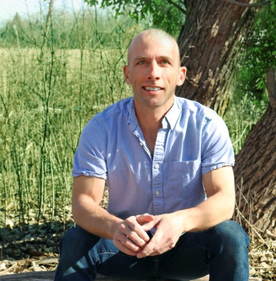 Jason sitting on a tree